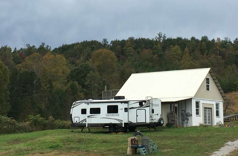 RV site has water hook-up with 3 step water filtration & can accommodate 50 amp plug-ins