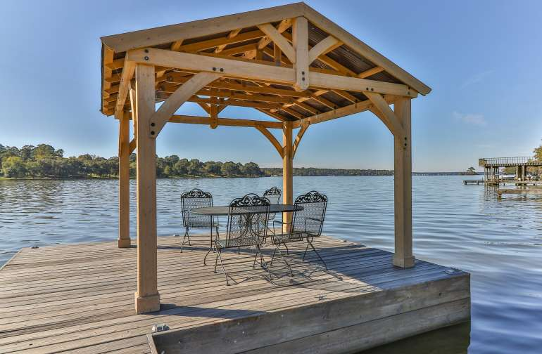 Just relax and lounge or fish from our covered boat dock