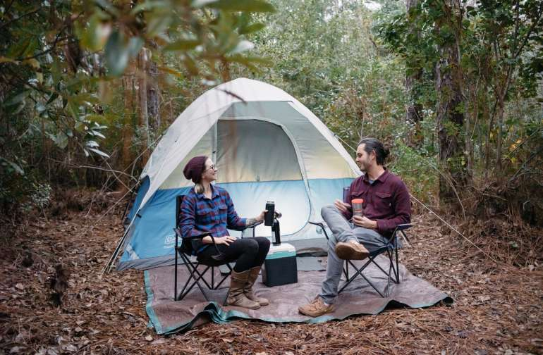 """Checking out on of the pre-setup """"glamping"""" spots. Huge air mattress already set up inside the tent."""