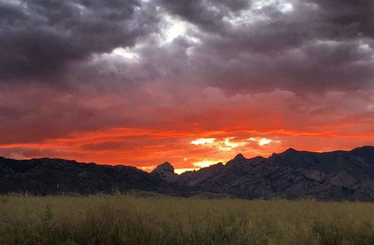Sitting on top of our property at sunset you get to sometimes see some amazing sunsets over Cochise Stronghold. WE have the best hill in the valley ;).