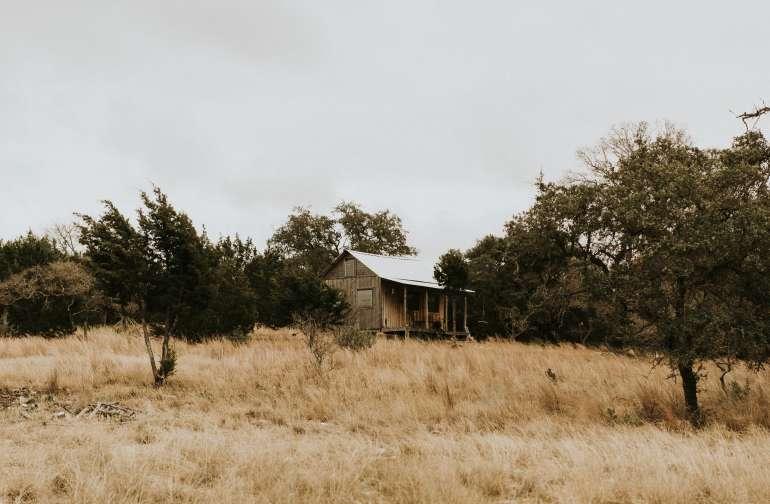 The cabin resembles a quaint little mountain cabin.