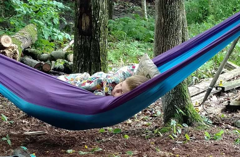Cole, wasn't feeling well while we worked on one of the campsites... So he snoozed in the hammock.