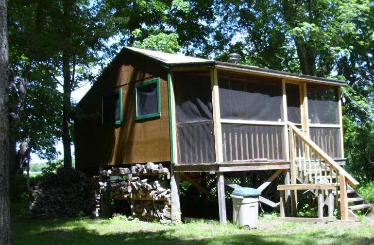 Cabin with screened porch can sleep four.