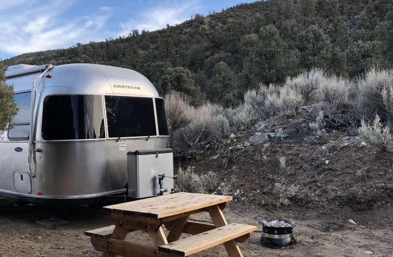 Outside the trailer, enjoy a picnic bench, outdoor seating, and a propane fire pit. Propane is provided.