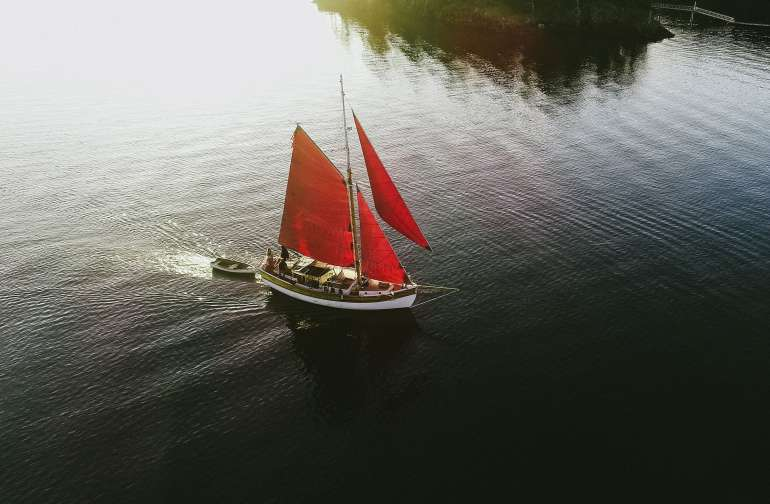 """This is """"Lille Danser"""" a traditional gaff rigged sailboat that you will be sleeping on and sailing. Along with Captain Clark you will set out on an adventure."""