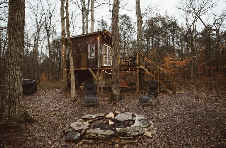 a big fire pit with chairs- there is firewood available under the treehouse!