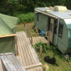 Boat, Tent & Trailer by stream