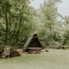 WOODEN TENT IN THE WOODS