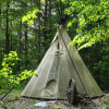 Tipi nestled in the woods