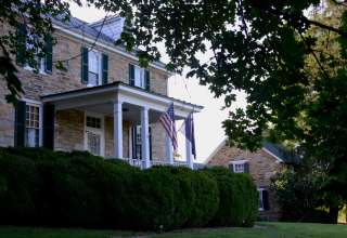 The beautiful 1812 farmstead stands tall among the acres of pastures surrounding it.
