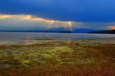 The best sunsets over the Adirondacks - The beach at Button Bay Campground.