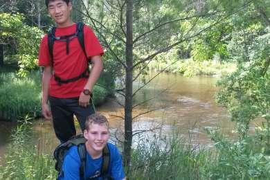 Boys along PM River