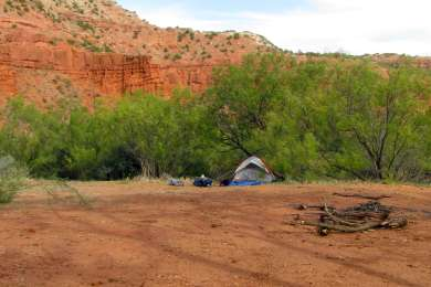 A communal pad makes up the primitive campground with sites along the perimeter. Photo by Lisa Rawlinson