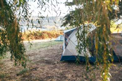 Tent site with a view of the Columbia River.