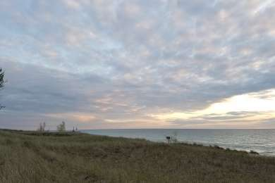 View south along the Lake Michigan shore at dusk. 30 steps from campsite.