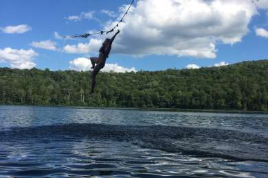 Rope swing over Russell Pond