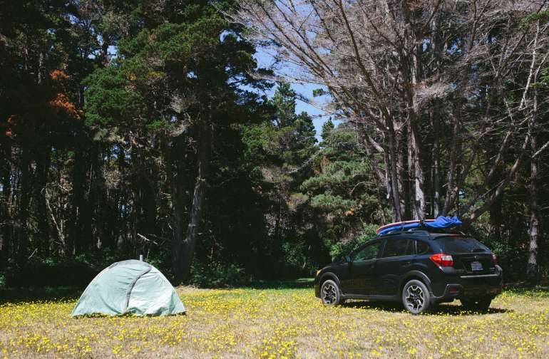 This campsite is perfect for group camping. This big open space allows at least 10 tents with the possibility to drive in. There is a giant fire pit with multiple water spigots and power outlets within this open field.