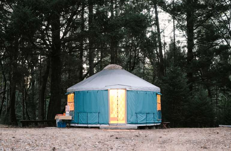 The yurt lit up at dusk!