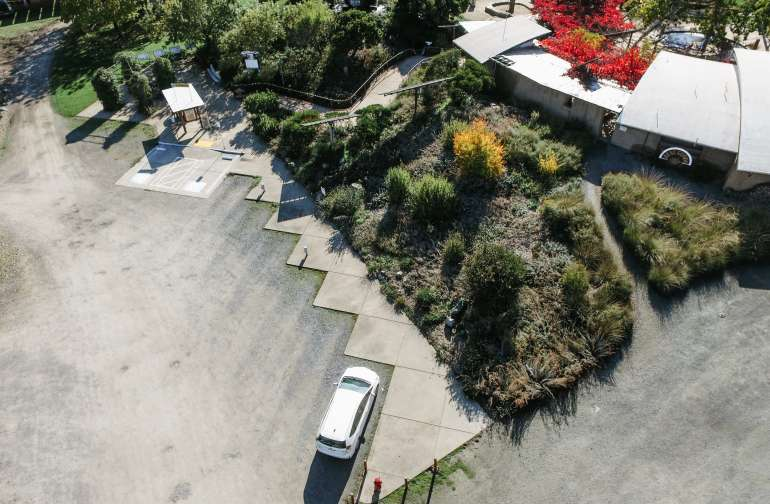Aerial view of electric vehicle parking area.