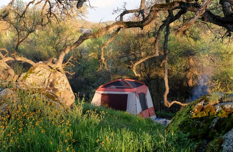 Looking down at the campsite from a nearby hill. Oak trees shade the outdoor kitchen.