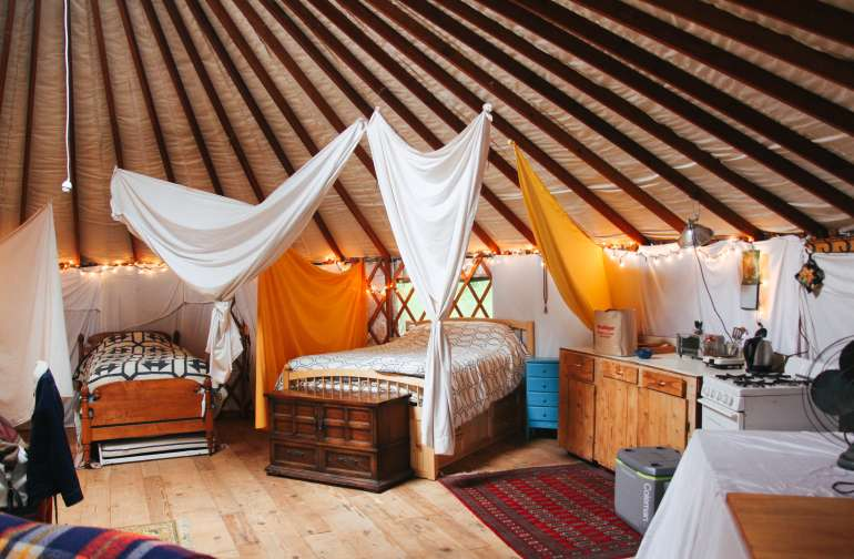 With plenty of sleeping options, the yurt would be a great place to come in a group. There is one queen, a full, a twin with a pullout bed, and the couch.