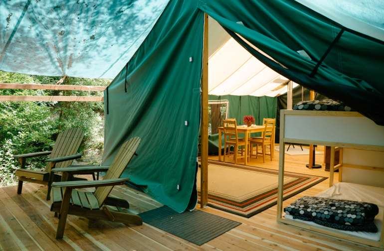 Afternoon light makes this glamping tent feel homey and welcoming