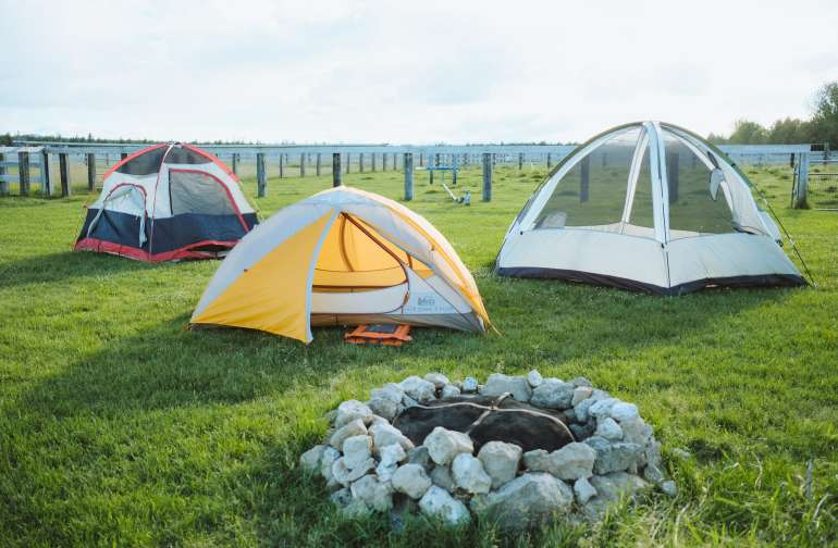The field area designated for tents is perfect for spreading out and enjoying the nice weather with friends or solo!