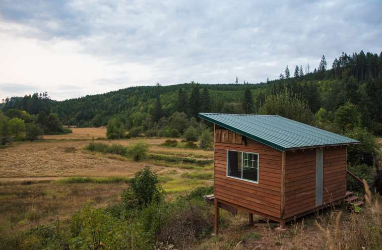 The cabin overlooking the meadow.