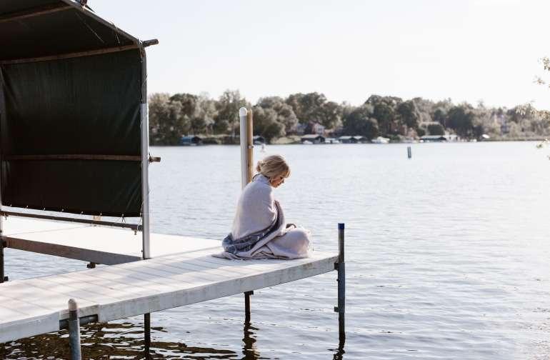 people lake camper