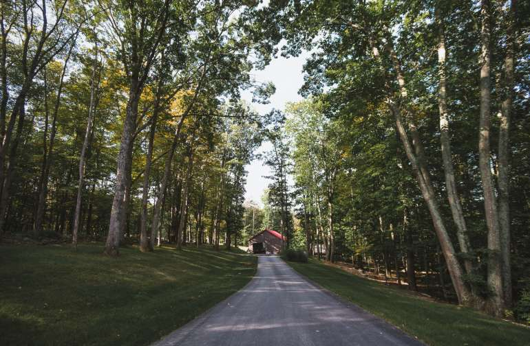 The approach to the property starts to set the stage for its wooded seclusion.