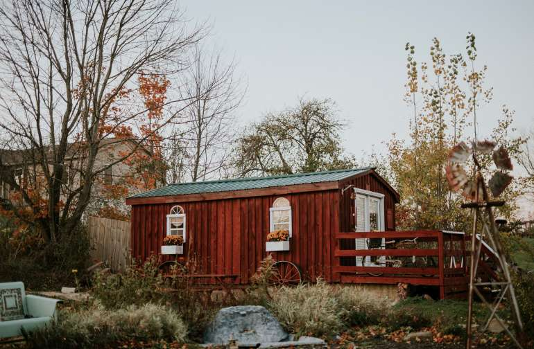 This bright red cabin with country charm will offer you a peaceful get away.