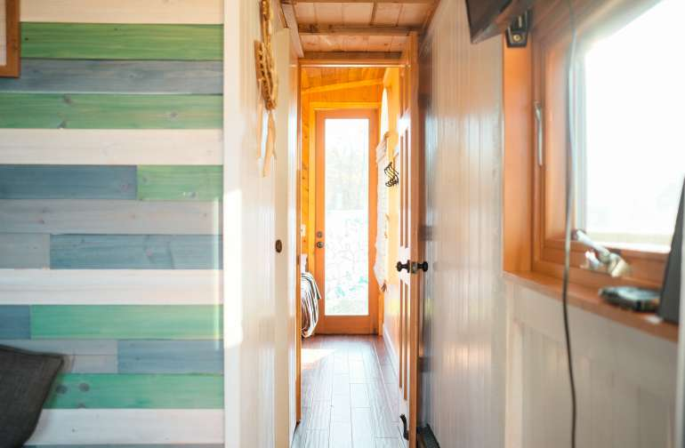 The hallway leading to the bathroom and second bed room.