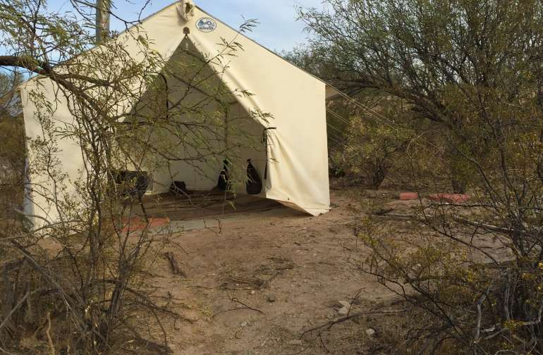 Cozy 10' x 10' tent with wood stove.