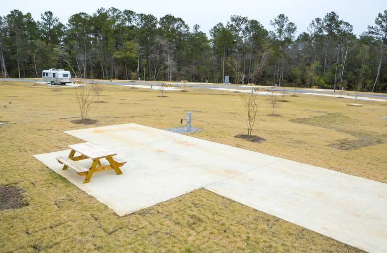 The RV Sites offer plenty of space and have water, electric and their own picnic table!