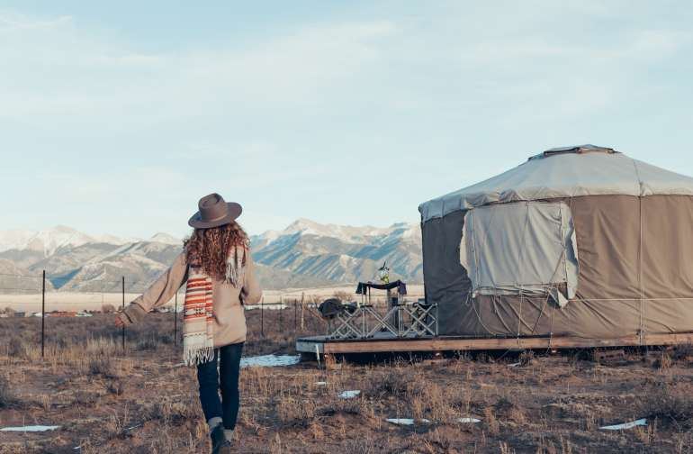 Happiness is a yurt with mountain views and camels for company.