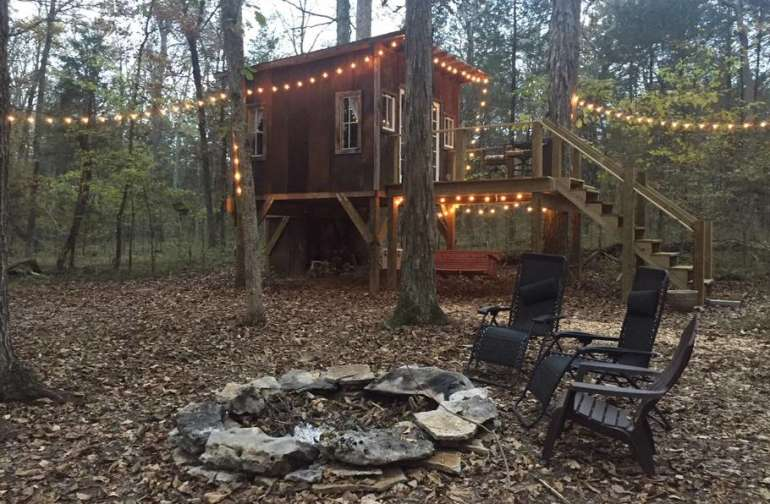 Adult treehouse with fire pit and hammock