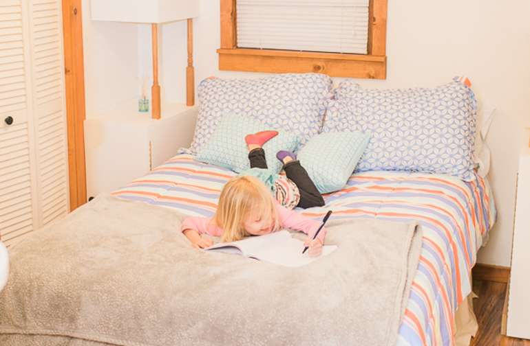 The cabin's comfortable bedrooms invite guests to take a great nap, or catch up on a great book (or color!)