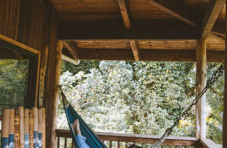 The back porch with seating, an amazing view and a hammock for relaxing and reading a book. Such a pretty spot to hang out