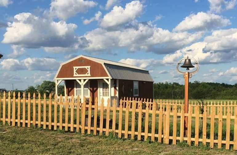 This quaint cabin has a full size bed, full bath and small kitchen. There is a mattress in the loft for smaller people.