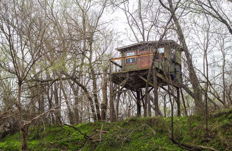 View of the beautiful treehouse from on the water.