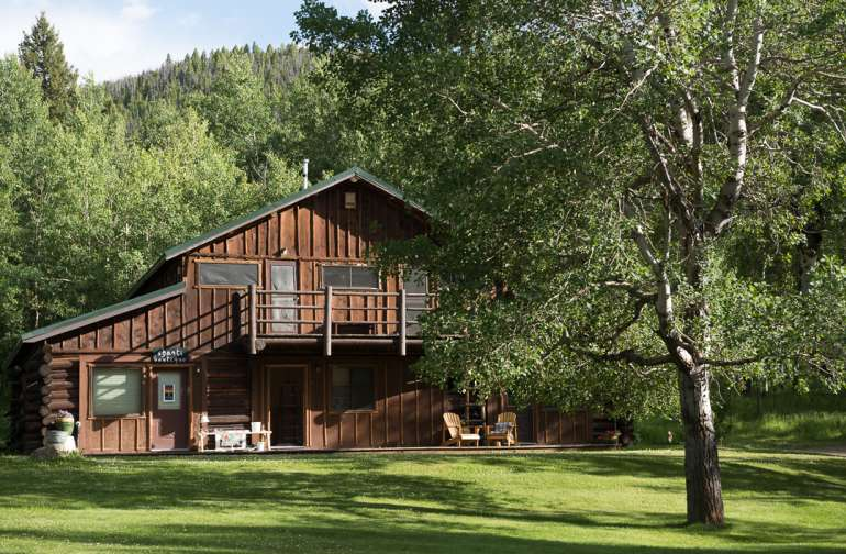The chalet offers spectacular views of the Ranch overlooking the lake and the mountains beyond. Shared bathrooms are available with a shared veranda.