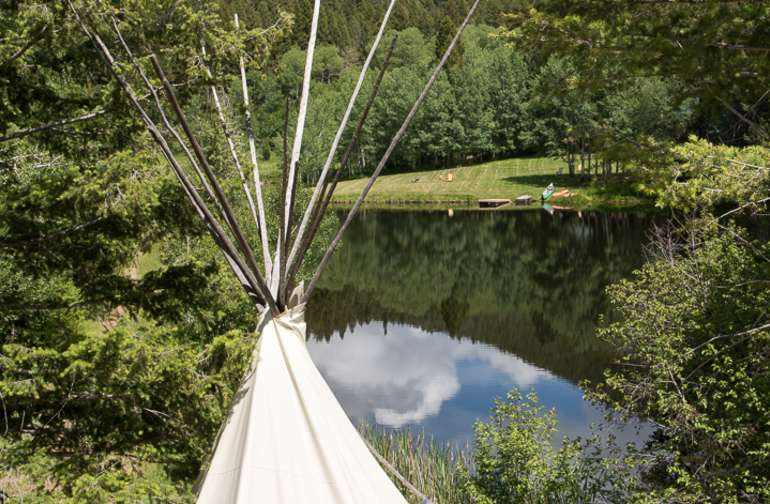 "Intimate connection with nature can be experienced in a Tipi; it's clear why the Plains Indian tribes developed this perfect nomadic dwelling. Our Tipis offer you an open ""eye to the sky"" with canvas walls that shift color, light and shadow during daylight."