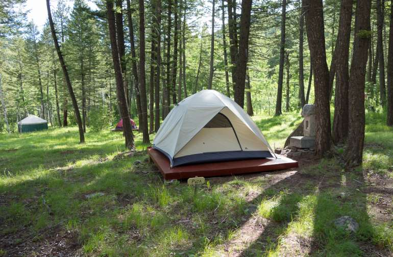 """Tent accommodations as well are hidden amidst the trees for those who truly want solitude to """"rough it,"""" the comfortable Feathered Pipe way. """"Roughing it"""" includes full access to the nearby bathhouse."""