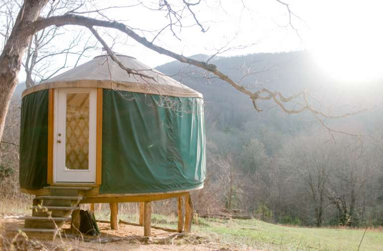 The yurt's front windows face the mountains, a perfect setup for watching sunrise.