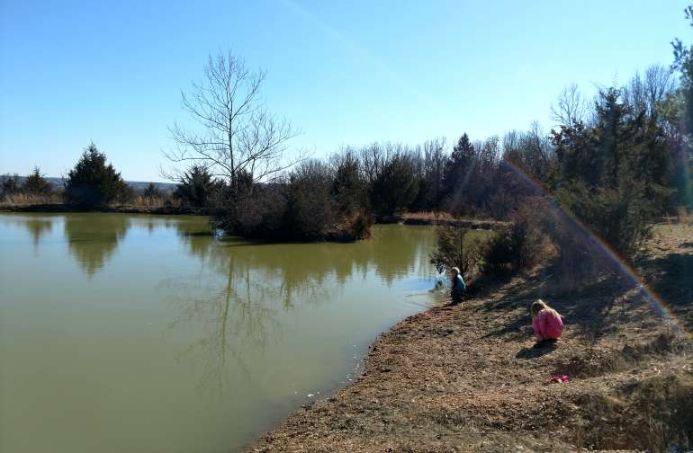 The 2 acre pond stocked with bass, catfish, and bluegill