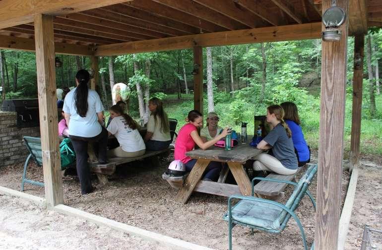 Summer camp riders enjoying a picnic at the shelter