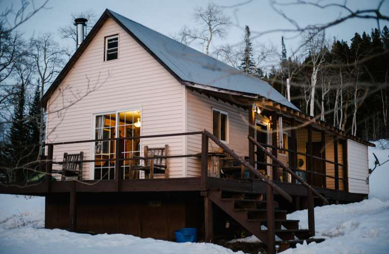 The view of the cabin right off the driveway. Be sure to bring a snow-capable vehicle in the winter!