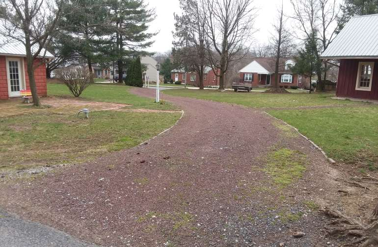 Rear entrance parking area for any RV.  This is on a 1 acre lot.  You'll have ample room to pull in and move around.