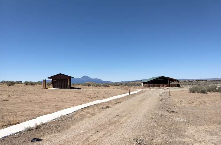 Men's bathhouse, Sleeping Ute Mountain in the distance & The Chapel- event space.