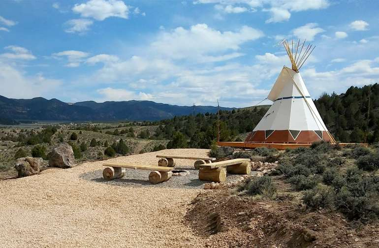 Soaring Hawk TIPI near Bryce Canyon and communal fire pit area.